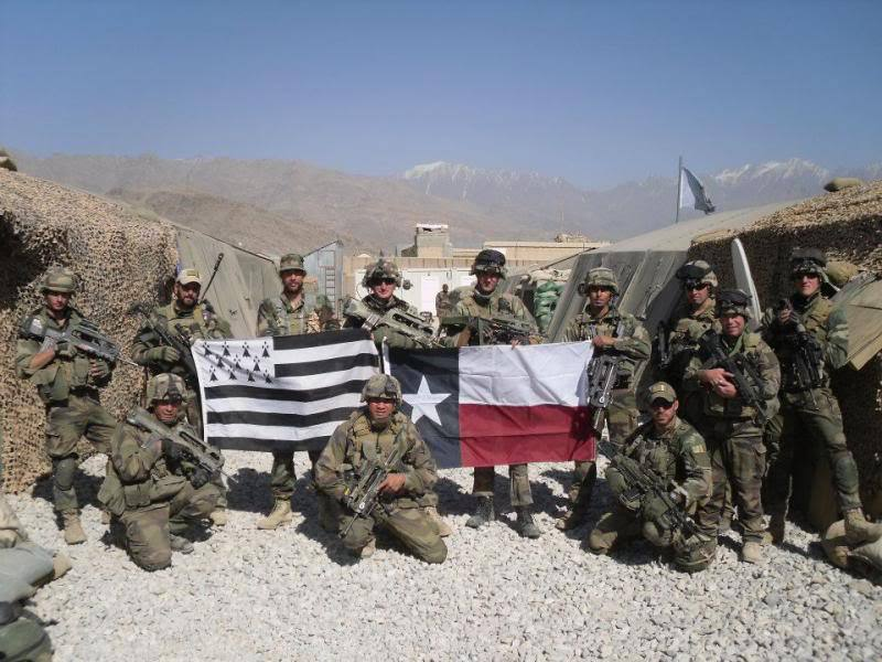 Chris HernandezUS Army soldiers with French Marine snipers and French Air Force JTACs, Firebase Morales-Frasier, Kapisa province, Afghanistan, Fall 2009. Author is standing at left side of French Bretagne flag, wearing tan ball cap.